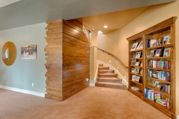 Basement Stairwell with Bookshelf closed and Wood Wall Detail